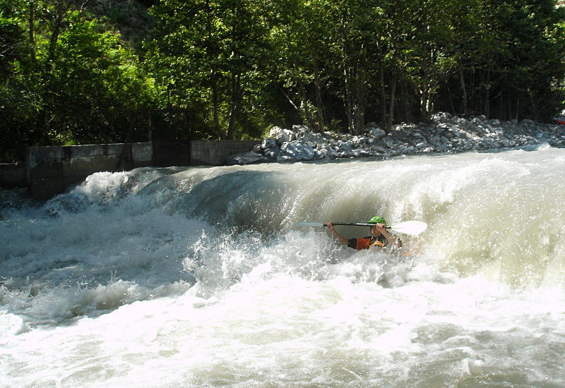 Mark dropping in to the stopper on the weir on the Gyronde on our first run